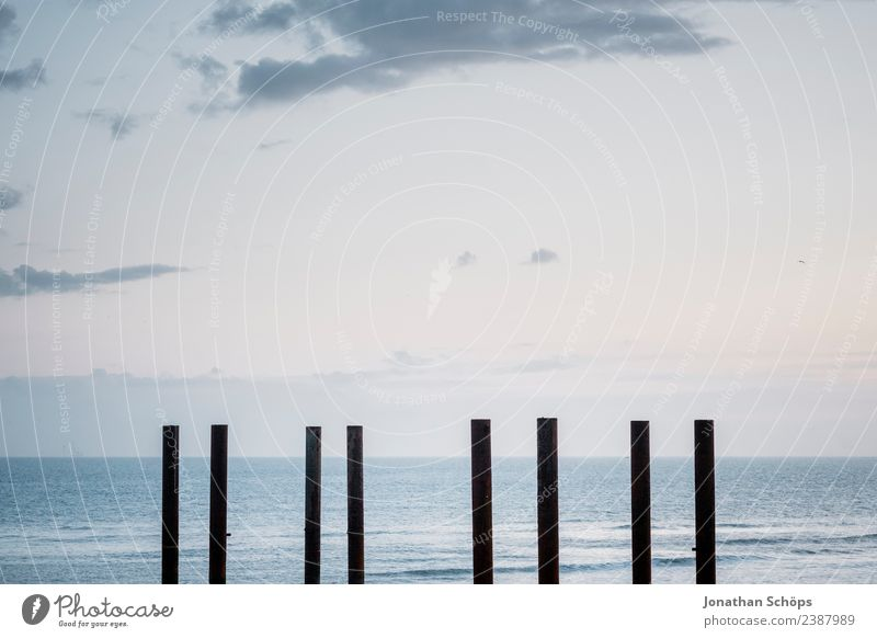 Poles at the beach in Brighton, England, south coast Water Sky Waves Coast Beach Tourist Attraction Landmark Monument Esthetic Wooden stake Ocean Minimalistic
