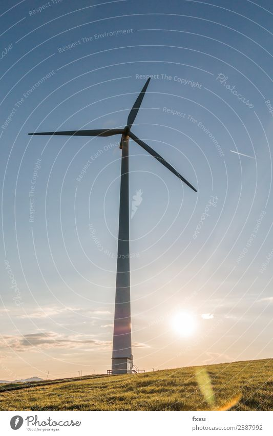 Wind energy Wind turbine in back light Wind energy plant Eco-friendly Energy Energy industry Environment Environmental damage Environmental protection Clouds