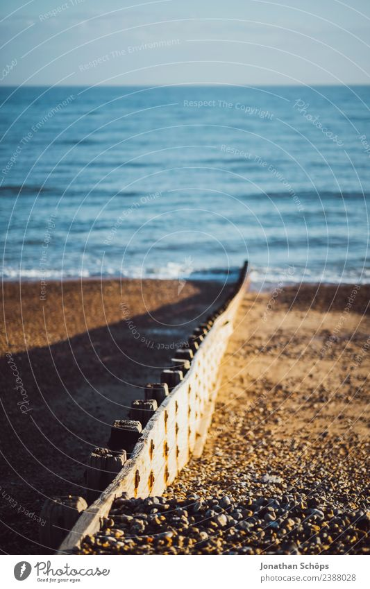 Separation wall at the beach, Brighton, England Environment Sky Sun Beautiful weather Snowcapped peak Coast Beach Ocean Island Esthetic Wall (barrier) Divide