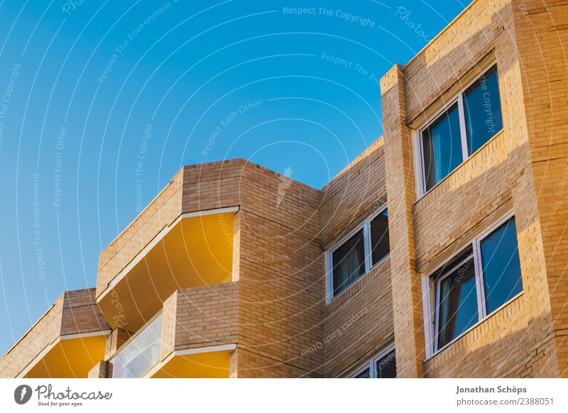 Sky Blue Town House (Residential Structure) Window Architecture Warmth Yellow Building Facade Vantage point Europe Simple Cloudless sky Balcony Brick