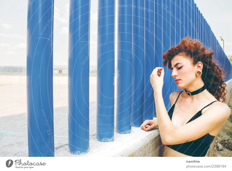 Young redhead woman against a blue wall Lifestyle Style Beautiful Hair and hairstyles Skin Face Human being Feminine Young woman Youth (Young adults) 1