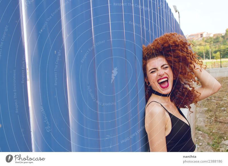 Cheerful redhead woman against blue wall Lifestyle Style Joy Hair and hairstyles Human being Feminine Young woman Youth (Young adults) 1 18 - 30 years Adults