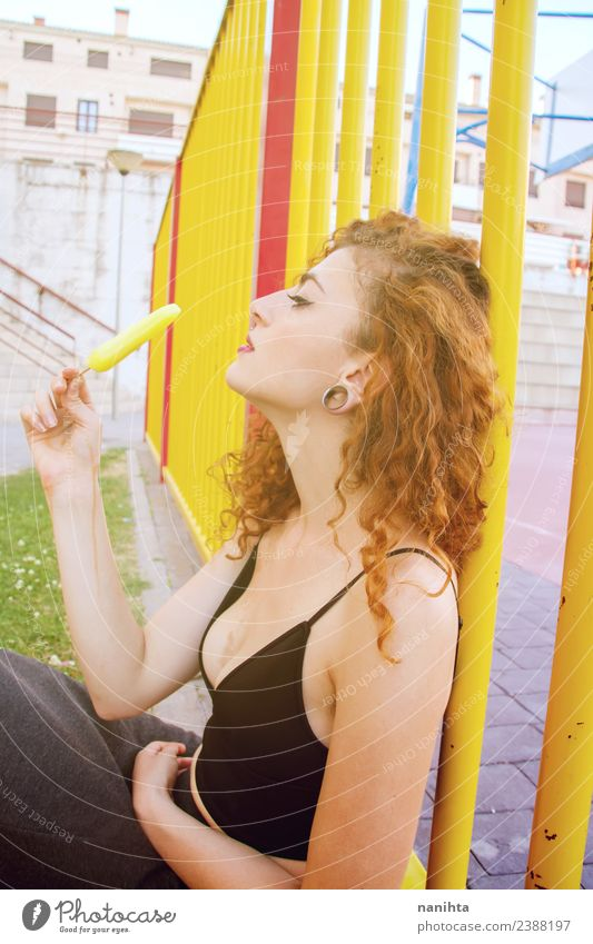 Young woman outdoors eating a lemon ice cream Human being Youth (Young adults) Summer Town Beautiful Eroticism Joy 18 - 30 years Adults Eating Warmth Lifestyle