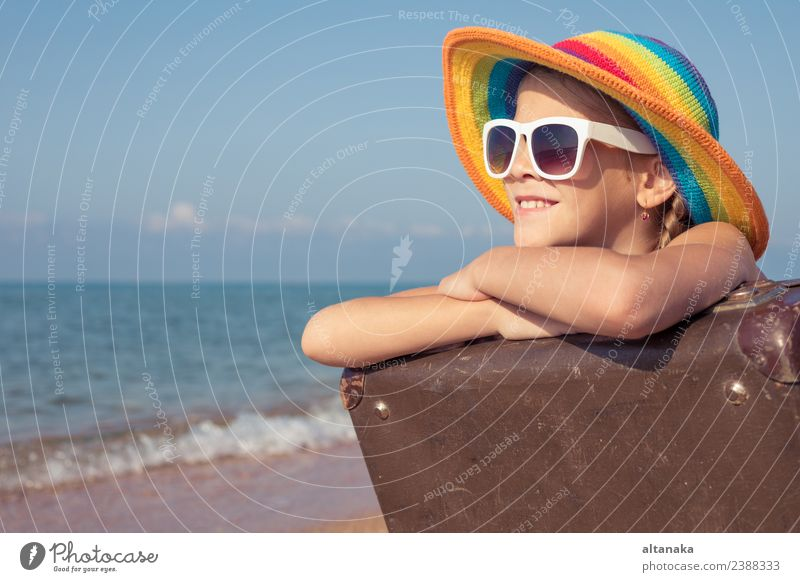 One happy little girl with suitcase sitting on the beach Woman Child Human being Sky Nature Vacation & Travel Summer Sun Ocean Relaxation Joy Beach Adults
