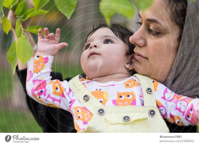Little baby is exploring and touching new spring leaves in her mother's hug Beautiful Life Relaxation Child Human being Baby Woman Adults Parents Mother