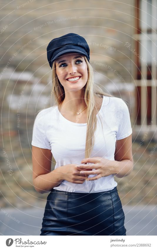 Young blonde woman smiling near a brick wall Lifestyle Style Happy Beautiful Hair and hairstyles Summer Human being Feminine Young woman Youth (Young adults)
