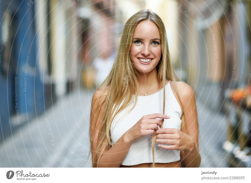 Smiling young woman in urban background. Woman Human being Youth (Young adults) Summer Beautiful White Joy 18 - 30 years Street Adults Lifestyle Autumn Feminine