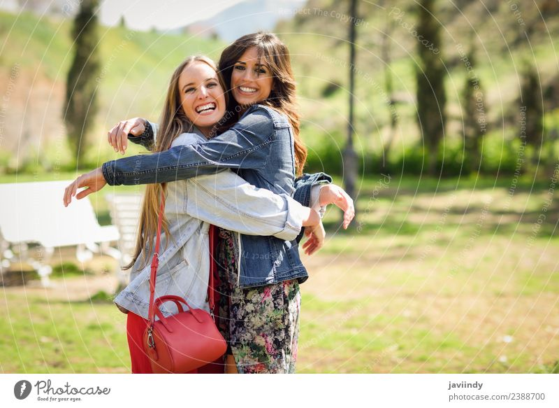 Two happy girls hugging in urban park. Woman Human being Youth (Young adults) Young woman Beautiful White Joy 18 - 30 years Street Adults Lifestyle Emotions