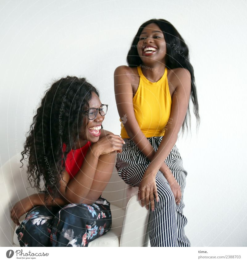 Apolline and Arabella Armchair Feminine Woman Adults 2 Human being T-shirt Pants Eyeglasses Black-haired Long-haired Curl Afro Relaxation Laughter Sit Joy