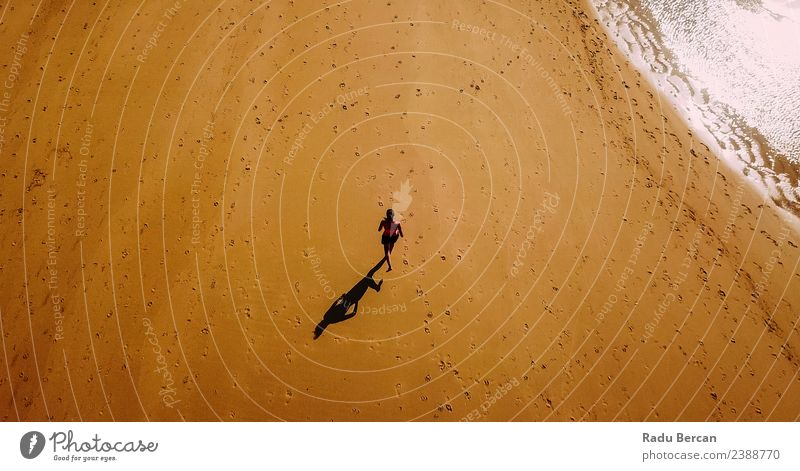 Aerial View Of Sportive Woman Running On Beach Athletic Fitness Adventure Summer Ocean Sports Sports Training Sportsperson Jogging Human being Feminine