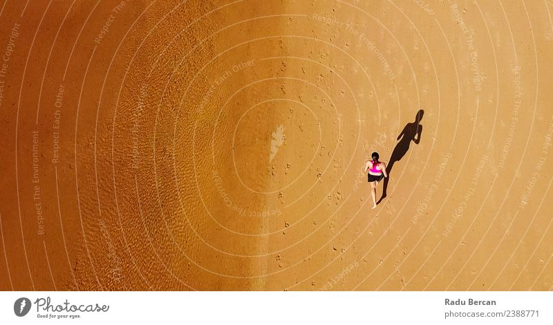 Aerial View Of Sportive Woman Running On Beach Healthy Athletic Fitness Life Adventure Summer Sun Ocean Sports Sports Training Track and Field Sportsperson