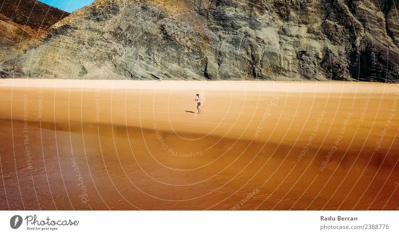Aerial View Of Sportive Woman Running On Beach Human being Nature Youth (Young adults) Young woman Summer Landscape Ocean Far-off places Mountain 18 - 30 years