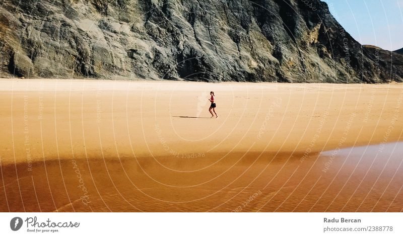 Aerial View Of Sportive Woman Running On Beach Human being Nature Youth (Young adults) Young woman Summer Landscape Ocean Mountain 18 - 30 years Adults Warmth