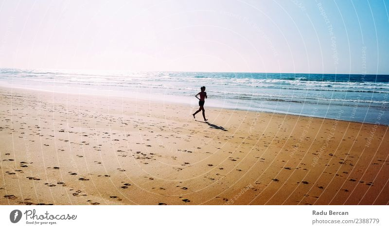 Aerial View Of Sportive Woman Running On Beach Healthy Athletic Fitness Life Adventure Summer Sun Ocean Sports Sports Training Track and Field Jogging