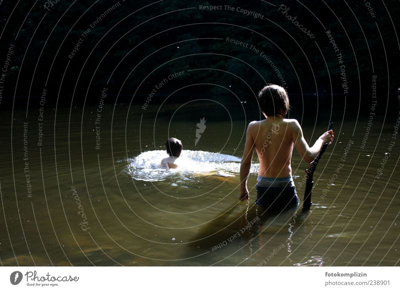 two children bathing in dark green water Adventure be afloat bathe Freedom Experiencing nature Summer Boy (child) Water Swimming & Bathing