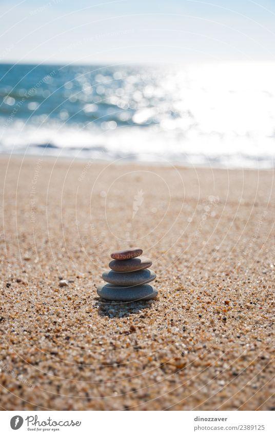 Stones stack on the sand Wellness Harmonious Relaxation Meditation Spa Summer Beach Ocean Nature Sky Horizon Rock Coast Natural Blue Black White Colour