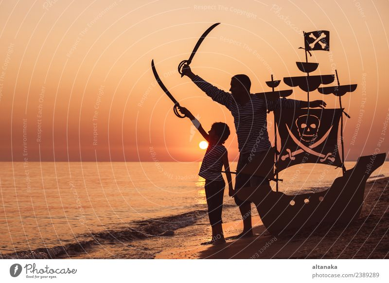 Father and son playing on the beach at the sunset time. Lifestyle Joy Happy Playing Vacation & Travel Trip Adventure Freedom Summer Sun Beach Ocean Sailing