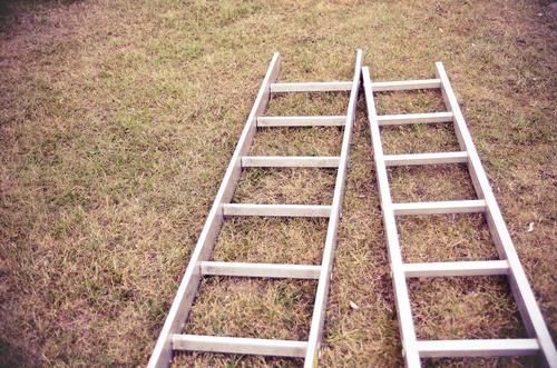 Two conductors Tool Ladder Beginning Aluminium 2 Lie Ground Grass Earth Brown Redecorate Build Colour photo Subdued colour Exterior shot Deserted