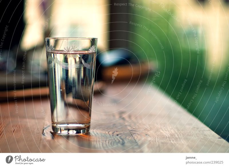 thirsty Beverage Cold drink Drinking water Glass Wood Water Fluid Brown Green Wetzlar Table Colour photo Interior shot Light Shadow Reflection Back-light Blur