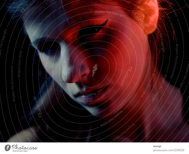 Human being Youth (Young adults) Blue Red Adults Face Dark Feminine Lighting Young woman Skin 18 - 30 years Threat Evil Visual spectacle Looking