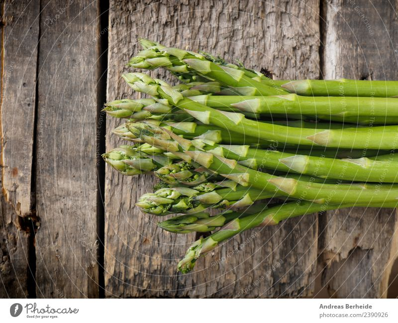 Fresh green organic asparagus on wood Food Vegetable Nutrition Organic produce Vegetarian diet Diet Healthy Eating antioxidant Asparagus Background picture