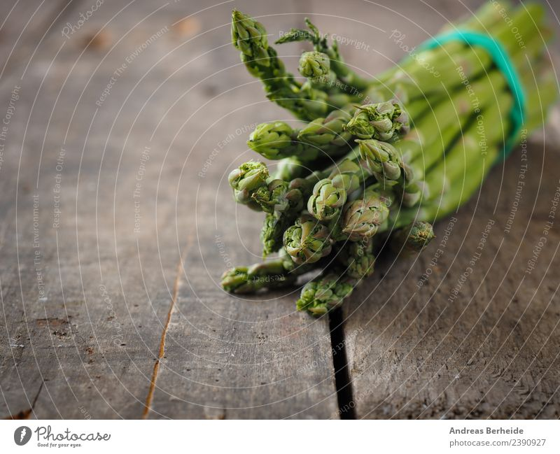 Green organic asparagus on a wooden table Food Vegetable Organic produce Vegetarian diet Diet Spring Delicious Healthy antioxidant Asparagus Background picture