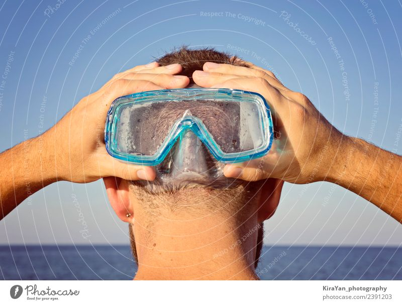 A man in a diving mask stands behind Vacation & Travel Man Blue Summer Hand Face Adults Lifestyle Funny Swimming & Bathing Leisure and hobbies Action