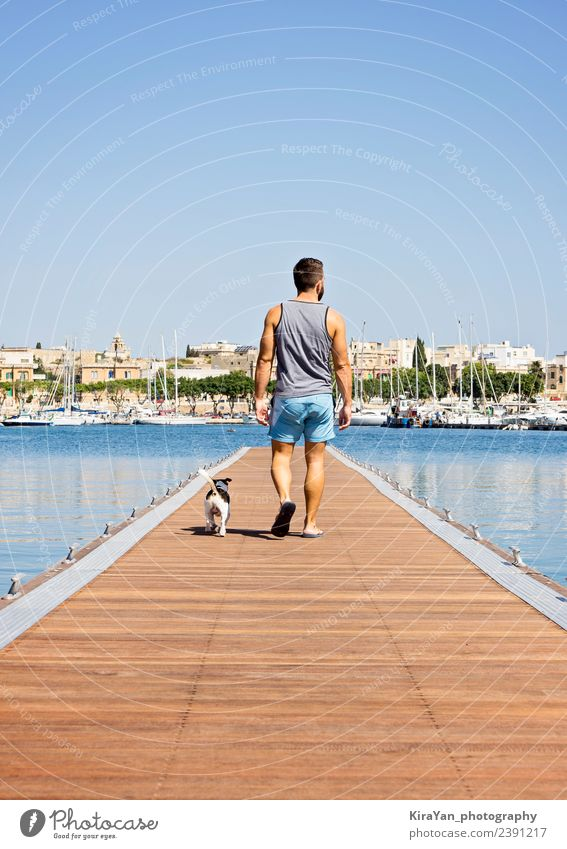 A man with a dog walking on the floating pier Happy Vacation & Travel Summer Sun Ocean Man Adults Friendship Nature Sky Autumn Coast Town Skyline Bridge Pet Dog