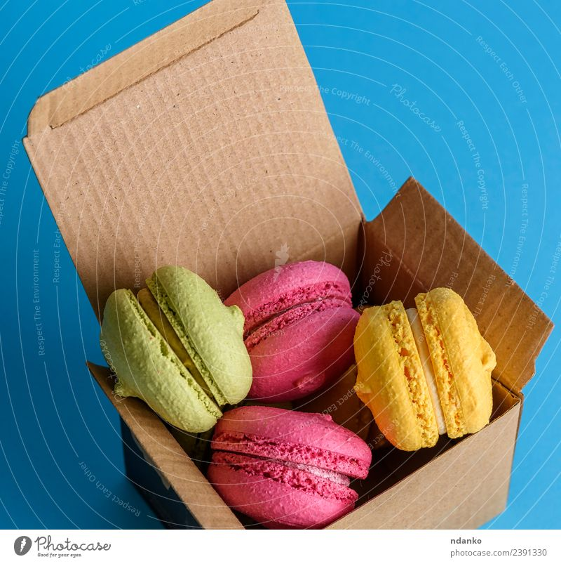 multicolored cakes Dessert Candy Paper Eating Bright Above Blue Yellow Green Pink Colour Macaron food colorful Vanilla french sweet biscuit Baking Bakery Almond