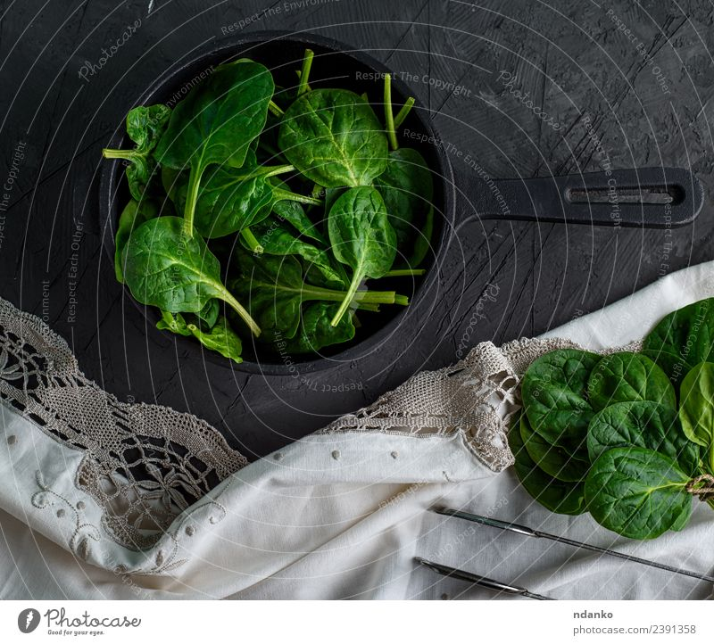 spinach in a round cast-iron frying pan Vegetable Herbs and spices Nutrition Vegetarian diet Diet Pan Nature Plant Leaf Eating Fresh Natural Above Green Black