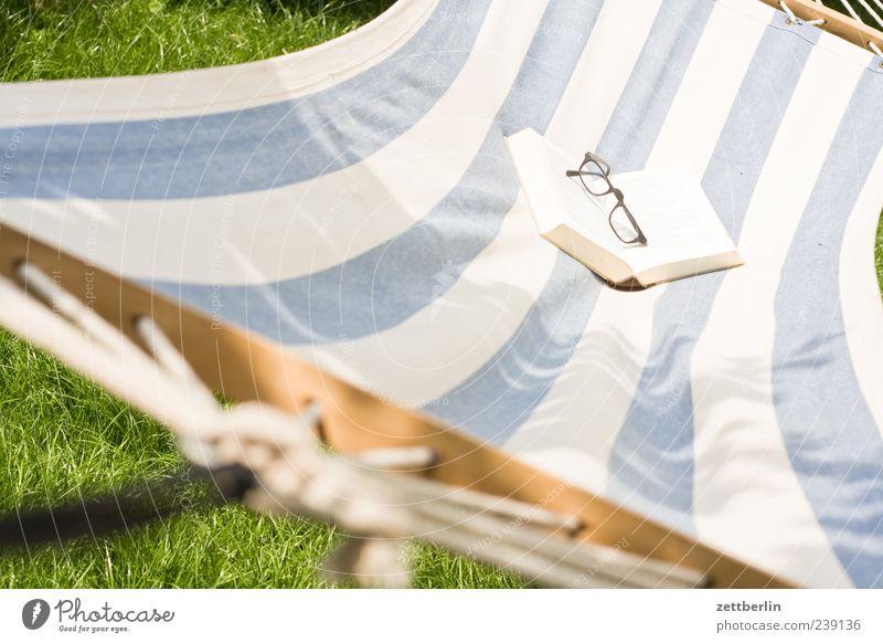 read Lifestyle Joy Relaxation Calm Vacation & Travel Trip Summer Summer vacation Sunbathing Living or residing Garden Print media Book Plant Hammock Eyeglasses