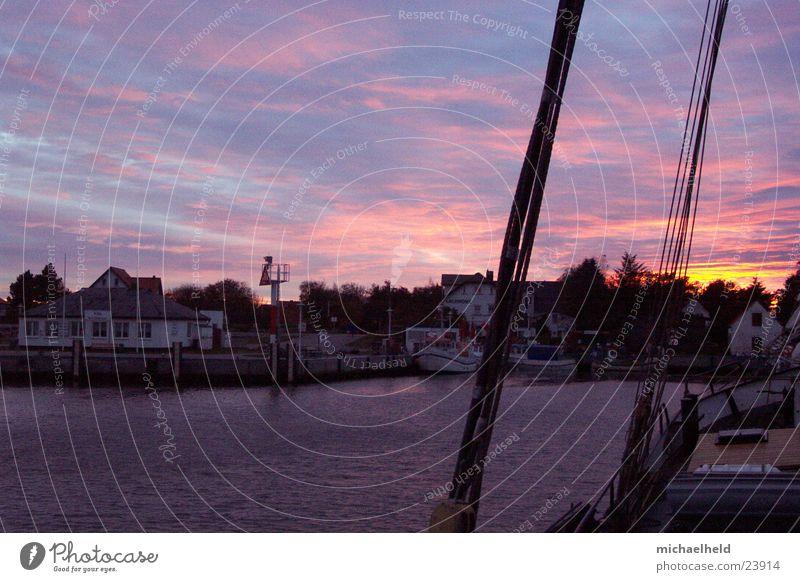 port atmosphere Vitte Hiddensee Clouds Watercraft Ocean Shrouds Fishing boat Fisherman Europe sunset Harbour