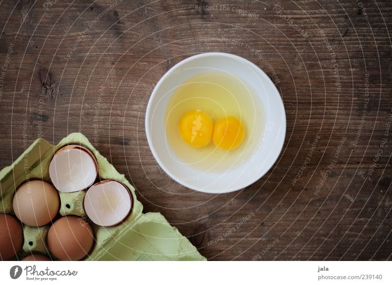 Do you like an omelet? Food Egg Nutrition Organic produce Crockery Bowl Simple Delicious Yolk 2 Eggshell Eggs cardboard Wooden table Colour photo Interior shot