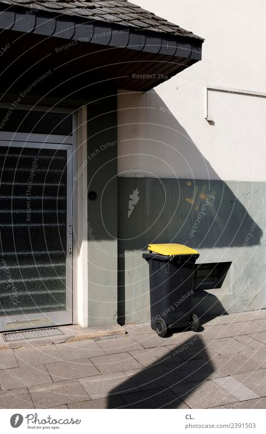 emptying date House (Residential Structure) Wall (barrier) Wall (building) Door Sidewalk Trash Waste management Trash container Sustainability Clean Yellow