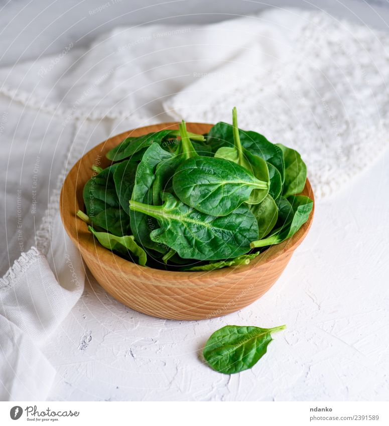 green spinach leaves Vegetable Lettuce Salad Herbs and spices Vegetarian diet Plate Bowl Table Nature Plant Leaf Wood Fresh Natural Green White Spinach food