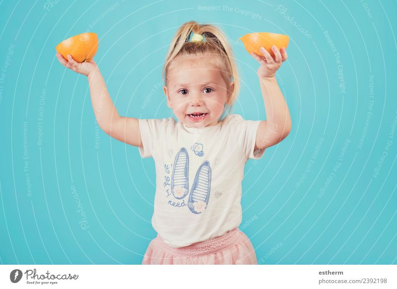 smiling baby with an orange on blue background Food Fruit Orange Nutrition Eating Lunch Lifestyle Joy Healthy Eating Human being Feminine Baby Girl Infancy 1