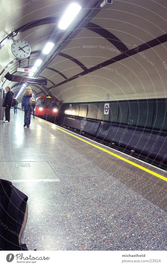London Underground 3 Platform Neon light Light Clock In transit Transport arriving train Human being Passenger