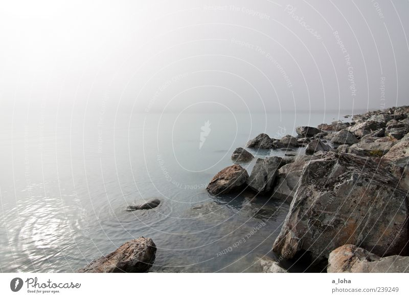 Sky Nature Water Loneliness Far-off places Environment Cold Autumn Coast Lake Waves Rock Fog Natural Travel photography Elements