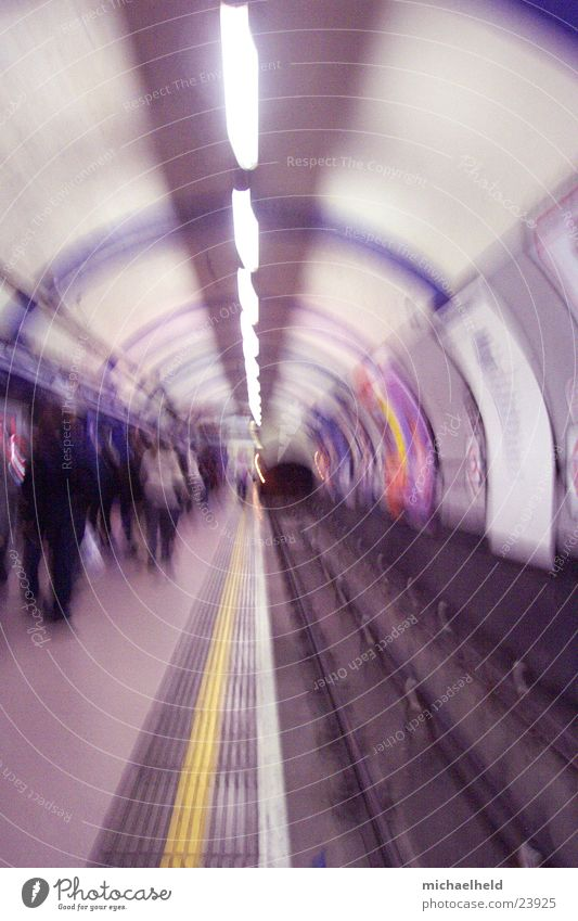 London Underground 2 Platform Neon light Light Railroad tracks Round Transport Blur Public transit Central perspective Tunnel vision Tunnel lighting