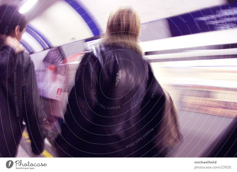 London Underground 1 Mobility In transit Backpack Woman Speed Driving Transport Human being Railroad Backwards Blur