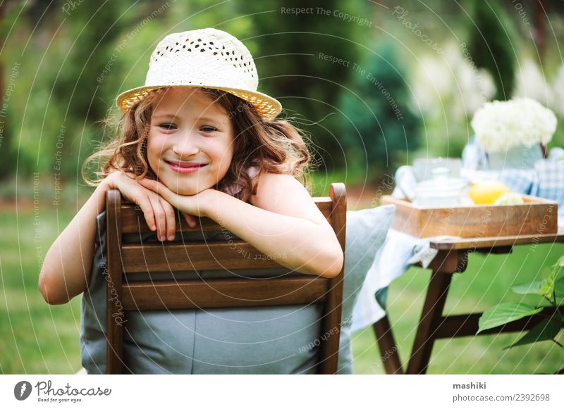 happy child girl in hat enjoying summer Breakfast Tea Joy Happy Leisure and hobbies Playing Vacation & Travel Summer Garden Decoration Chair Table Child Nature
