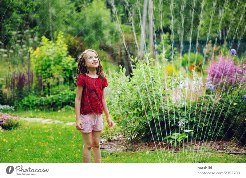 Kid girl playing with garden sprinkler Joy Happy Playing Summer Garden Child Infancy Weather Warmth Flower Grass Drop To enjoy Smiling Jump Happiness Hot Bright