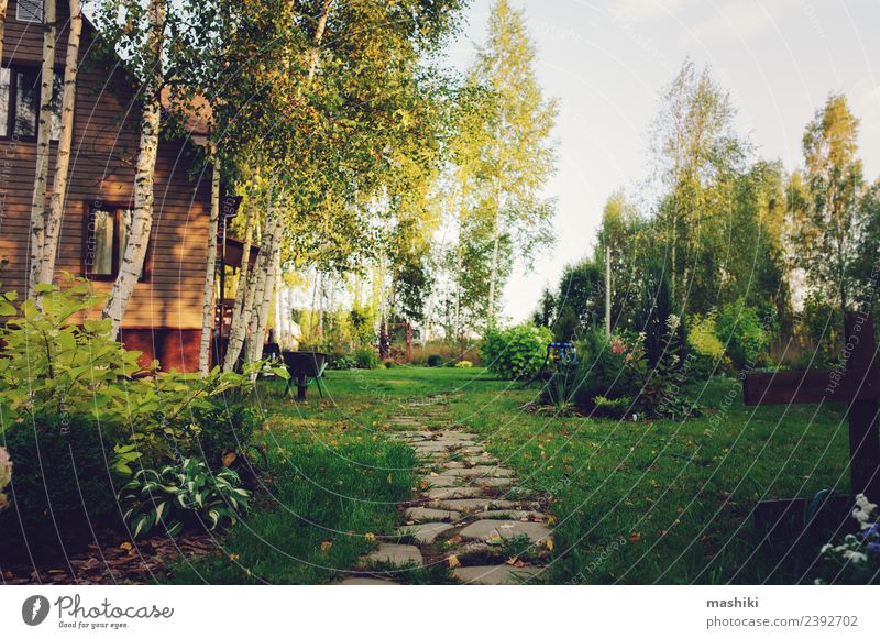 country garden view with wooden house - a Royalty Free Stock Photo ...