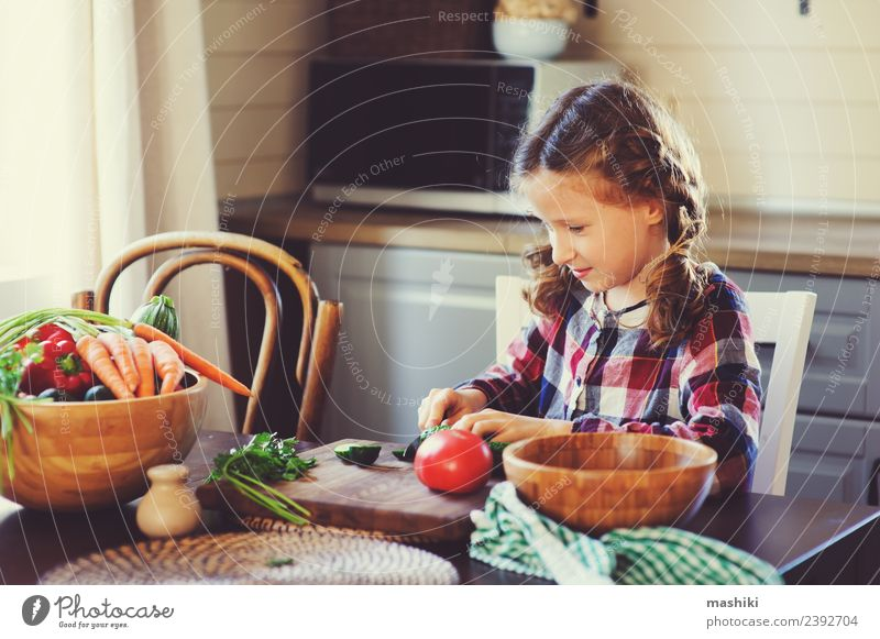 child girl help mom to cook Vegetable Lunch Dinner Lifestyle Joy Happy Table Kitchen Child Mother Adults Family & Relations Growth Fresh Small Salad knife Cut