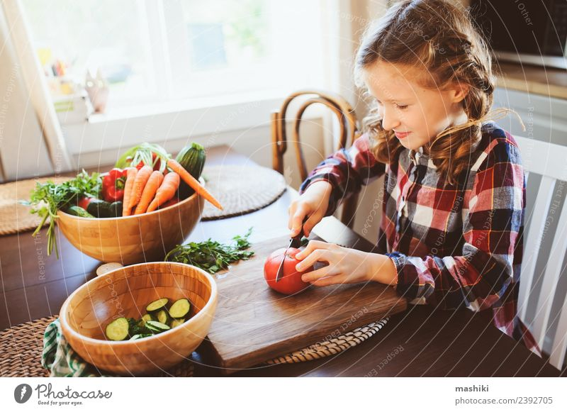 child girl helps mom to cook Vegetable Lunch Dinner Lifestyle Table Kitchen Child Mother Adults Family & Relations Growth Fresh Small Salad knife Cut Helper kid