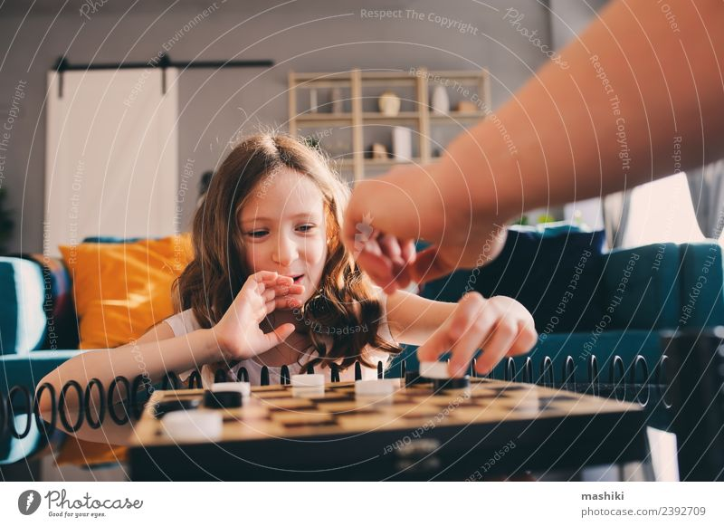 child girl playing checkers with dad Lifestyle Leisure and hobbies Playing Chess Success Child Parents Adults Father Family & Relations Infancy Toys Think