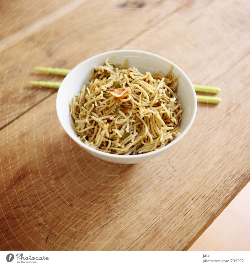 wok noodles Food Nutrition Lunch Vegetarian diet Asian Food Bowl Delicious Wooden table Chopstick Colour photo Interior shot Deserted Copy Space top