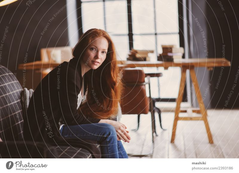 young readhead woman relaxing at home Tea Lifestyle Relaxation Knit Chair Table Woman Adults Autumn Warmth Sweater Red-haired Wood Metal Dream Dark Hot Modern