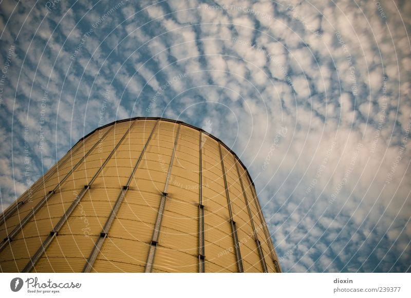 silo Sky Clouds Mannheim Germany Outskirts Deserted Industrial plant Harbour Manmade structures Silo Grain silo Barn Metal Gigantic Large Tall Blue Yellow White