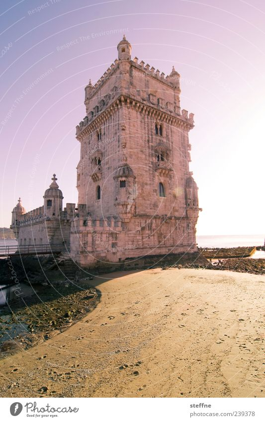 Tower of Bethlehem Sand Sky Beautiful weather Coast Lisbon Portugal Capital city Port City Old town Deserted Tourist Attraction Landmark Tower of Belem Stone